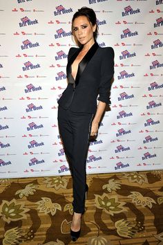 Victoria Beckham wearing a sleek black suit | Women in Suits - Female Celebrities in Pant Suits and Tuxedos - ELLE