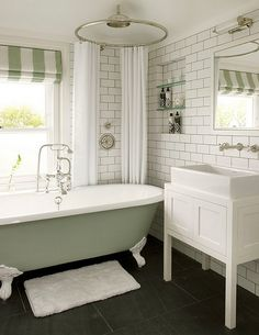 Bathroom : Modern Bathroom Green Pastel Hues Round White Curtain Freestanding Whirlpool Tub White Bathroom Vanity Wall Mirror Subway Wall Tile Recessed Floating Shelves Stainless Steel Shower Faucets Doormat Symmetrical Steps in Building Modern Bathroom Modern Bathroom Idea. Contemporary Bathroom Design. Bathroom Designs.