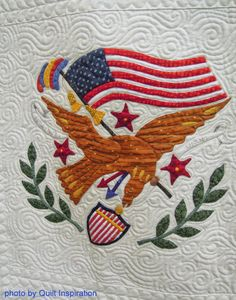 "close up, Eagle block, in: Album Quilt by Louise Robertson, quilted by Karolyn ""Nubin""Jensen.  Photo by Quilt Inspiration."
