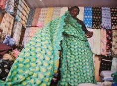 An African Lace seller at work