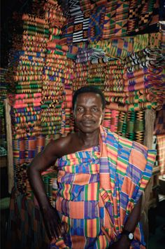 checkoutafrica: Kente cloth merchant displays his wares at a market in Accra, Ghana.