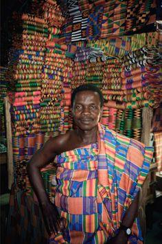 Africa | Kente cloth merchant displays his wares at a market in Accra, Ghana. | ©Jonathan C Katzenellenbogen/