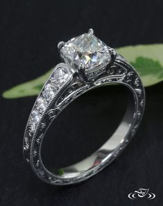 Cushion Cut Diamond Antique Engagement RingA cushion cut diamond is centered by graduated diamonds cascading down the shoulders of this platinum antique style engagement ring. A bridge of diamonds accent the dramatic prong setting. Filigree details and engraving are highlighted by a bright polished finish.#Ido #GreenLakeMade #EngagementRing