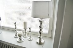 Would love to get two of those lamps to our new bedroom.. Wouldn't mind about haveing the candle holders either though