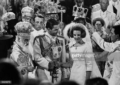 King Constantine of Greece and Princess Anne-Marie of Denmark during their wedding in Athens Cathedral. The service was conducted by Archbishop Chrystostomos, the Primate of the Greek Orthodox Church (left).