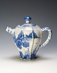 A Dutch Delft teapot and cover, circa 1700. Of faceted, baluster form, painted in cobalt blue in Chinese 'Transitional' style with a rocky landscape, the short, straight spout with touches of cobalt, the plain loop handle decorated with a continuous scroll and beads of colour, the cover with a button knop washed with cobalt, 14cm. Burghley Collections