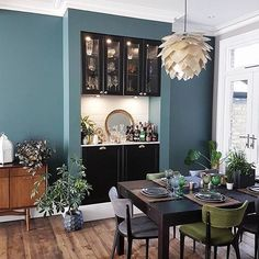 This is what dining dreams are made of! Restoring Lansdowne has created the perfect entertaining space and transformed her chimney breast in to a bar. Paired with walls, mid-century furni Green Dining Room, Dining Room Walls, Dining Room Design, Living Room Decor, Dining Room With Bar, Dining Area, Kitchen Dining, Farrow Ball, Chimney Decor