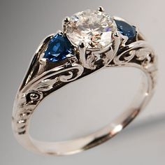Wedding ring. Would be absolutely perfect with and infinity band and on one side ur birthstone and ur husbands birthstone!