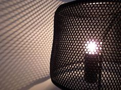 hiroomi tahara: mesh lamp  based in milan, japanese designer hiroomi tahara has created a 'mesh lamp.'  using a lightweight mesh for its shade, this lamp's simple materials and resulting structure creates a straightforward lighting solution.