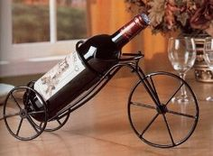 "900033 Black wrought iron metal single bottle bicycle wine r.- 900033 Black wrought iron metal single bottle bicycle wine rack Black wrought iron metal single bottle bicycle wine rack, welded solid no parts move. Measurements: 15 "" x 3 x 7 H SKU - Wine Deals, Wine Bottle Holders, Coaster Furniture, Wine Furniture, Furniture Design, Candle Stand, Wine Storage, Storage Rack, Welding Projects"