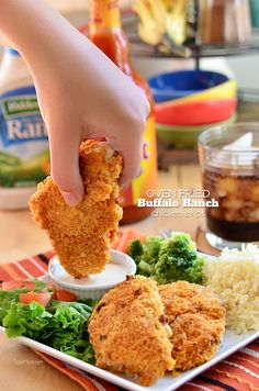 These crispy oven fried Buffalo Ranch Chicken strips are crisp-crusted moist and tender fiery buffalo sauce slathered where's the ranch dip chicken fingers. recipe at TidyMom.net