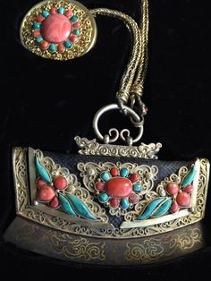 Flint and tinder pouch for Mongolian men, 19th century. Gilt silver, steel, leather, coral and turquoise.