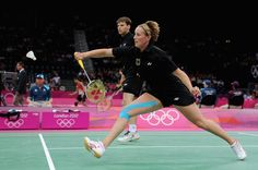 German mixed doubles team both sport blue knee applications in their match against Team GB