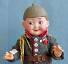 Antique German Bisque Googly Eyes Boy with Molded Helmet from abigailsattic on Ruby Lane