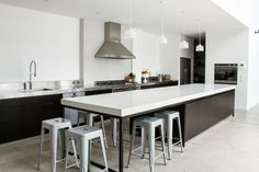 example of long simple island with seating around end - (too much white however - not my style kitchen)