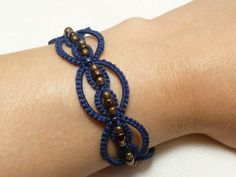 Tatted Navy Blue Bracelet with glass beading-Infinity. $15.50, via Etsy.