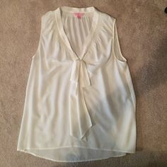 100% Silk Super Cute Lilly Pulitzer Tank Top!! Super cute Lilly Pulitzer tank top! This is 100% silk and has an adorable bow in the front! Perfect for summer -- can be easily dressed up or dressed down. It's in excellent used condition. Lilly Pulitzer Tops