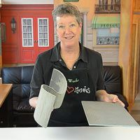 woman holding wedi board and wedi sculpture