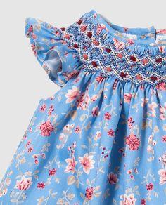 Vestido de bebé niña Tizzas en azul con estampado floral