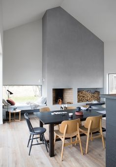 Fireplace in the center of this Scandinavian Oslo house.