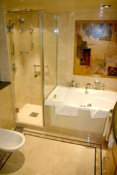 spa tub and shower small bathrooms | Owner's Suite Bathroom With Separate Shower  and Tub.