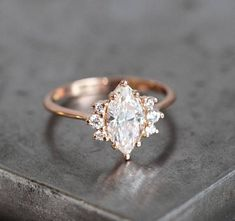 0.9 carat marquise diamond ring with side diamonds. Ring online is 18K rose gold. Price is for marquise diamond ring only. This design can be also made with other gemstones per request. IF YOU WANT A CUSTOM ring please contact me before purchase. Our diamonds listed are all natural with