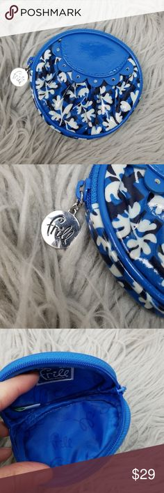 Vera Bradley Blue White Frill Circle Coin Purse Vera Bradley Blue White Frill Circle Coin Purse in excellent used condition. Very cute!  Please let me know if you have any questions. Happy Poshing! Vera Bradley Bags Mini Bags