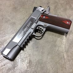 Stainless Colt 1911 rail gun. This is a sweet sweet piece!! Love my Glocks, but this is my overall Favorite gun. Colt 1911.