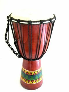 """Djembe Drum Bongo Hand Drum, African Drum - Percussion - 20"""" Professional Sound by World Bazaar Imports. $84.99. Perfect for any music lover. Beautiful colors that will enhance any decor. Handcarved by skilled artisans. Fair Trade Item. Great meditation yoga tool. Artist Wade Pur presents a jambe drum handcarved from sustainable mahogany wood and embellished with a bright tribal motif depicting the playful nature of this instrument.A resonant goatskin drum head is af..."""