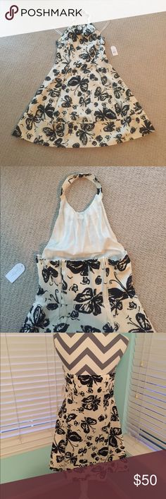 Jessica Simpson Halter Dress - Size 10 NWT Jessica Simpson Cream And Black Butterfly Halter Dress...Size 10....This Dress Has Never Been Worn...Please Feel Free To Like...Comment....And Share...😍 Jessica Simpson Dresses Strapless