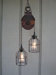 Upcycled Vintage Farm Pulley Lighting Pendant with Bulb Cages. BenclifDesigns, via Etsy.