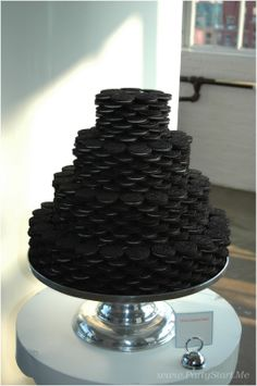 "Oreo cookie ""cake"". Would love to do this for Andy's groom's cake since he can't have cake. Maybe drizzle chocolate over it like those white fudge Oreos...yum!"