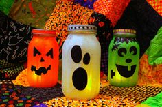 mason jars, a little bit of tissue paper, a whole lot of mod podge, a tea light or two… & you have hallowen-inspired mason jar lanterns – perfect for your holiday monster mash.