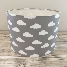 Handmade to order to coordinate perfectly with our Grey Clouds range of bedding, blankets and baskets. Our new range of lampshades measure 21cm high with a diameter of 30cm. Available with ceiling pendant option or table lamp option. What type of lamp holder will this lampshade fit