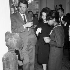 Actor Gregory Peck, Veronique Peck, and unidentified woman admire African art at National Museum of African Art #tbt #africanartat50 #africa