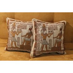 When you add these hieroglyph decorative throw pillows to your sofa or bed, they're sure to garner attention and have guests give walking like an Egyptian a whirl. This unusual set of pillows features an ancient scene and hieroglyphs in neutral colors.