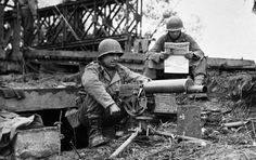 """""""Hurry up and wait..."""" US soldiers with a browning .30cal machine gun."""