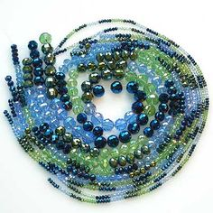 Super-sparkly faceted glass beads in blues and greens