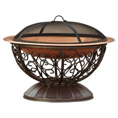 """Covered copper fire pit with powder-coated steel scrolling.  Product: Fire pitConstruction Material: MetalColor: Black and copperFeatures: Withstand temperatures to 1,000 degreesDimensions: 15"""" H x 35"""" Diameter"""