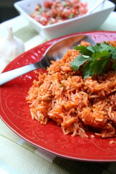 "Spanish Rice- Had to add a cup or more of broth so rice cooked properly but it might've just been because I was using a 10"" frying pan to cook it with.  Would add the whole jalapeno next time too and maybe some green chilies but good enough recipe!"