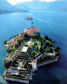 Offshore from the lake town of Stresa, the little island now occupied by the palazzo of the… Beautiful Places To Visit, Wonderful Places, Places To Travel, Places To See, Image Nature, Little Island, Beautiful Castles, Beautiful Islands, Italy Travel