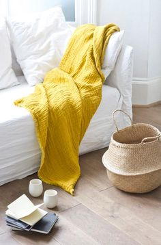 really like the splash of yellow in this linen throw