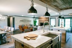 "Joanna Gaines.. ""After taking down so many walls to open up this space, the kitchen area lacked definition. This was one of the most important spaces in the home, so we raised the ceiling and added raw shiplap to define the space and add warmth."""