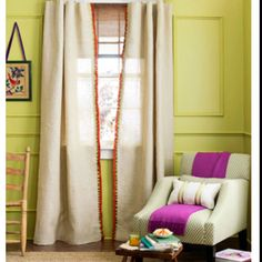 designmeetstyle: Adding sparkle to a space is as simple as finishing a pretty pair of burlap curtains with a Pom-Pom trim. It adds an unexpected pop of color and whimsical accent to this pretty room. Any local fabric or trim store offers a wide variety of finishes including tapes that have geometric patterns or Pom-Poms like above. If you don't have time to sew simply use iron-on bonding tape. Pretty and perfect in no time.