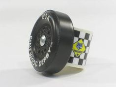 Neckerchief slide made out of pinewood derby wheels