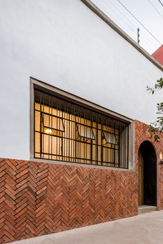 Casa DF (DF House) is located in the heart of Guadalajara, a few blocks away from the Templo Expiatorio (Expiatory Temple), one of the most beautiful and rep. Brick Cladding, Brick Facade, Brickwork, Facade House, Facade Design, House Design, Garden Design, Brick Crafts, Casa Patio