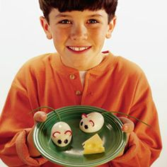 Hard Boiled Egg Mice - With chive tails, radish ears, and olive eyes, hard-boiled eggs get transformed into whimsical critters (that like to be served wedges of cheese, please).