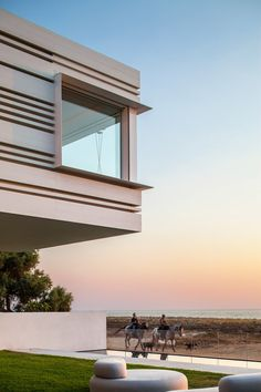 Horizontal slits create lines of shadow across the facades of this beachfront house in Israel by Pitsou Kedem Architects, which has a cantilevered upper storey that projects towards the Mediterranean Sea. Beachfront House, Beachfront Property, Cubic Architecture, Architecture Design, Porches, Pitsou Kedem, External Cladding, Aluminium Cladding, House By The Sea
