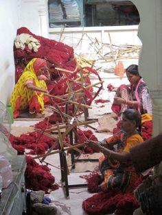 Women spinning yarn in India
