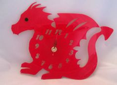 Dylan the dragon clock.   Measurements = 26cm wide x 20cm high  Handmade and laser cut in Pembrokeshire, South West Wales.  acrylic dragon clock laser cut  £20 & p&P